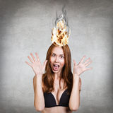 Woman having her brain on fire because of stress Stock Images