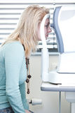 Woman having her eyes examined Royalty Free Stock Photos