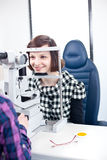 Woman having her eyes examined by an eye doctor Royalty Free Stock Image