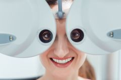 Woman having her eyesight measured with phoropter Stock Images