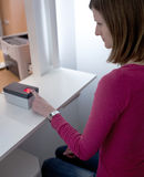Woman having her fingerprints scanned Stock Photo