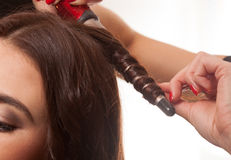 Woman having her hair curled Stock Photo
