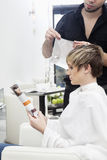 Woman having her hair highlighted Stock Photos