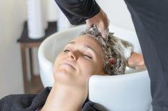 Woman having her hair shampooed Stock Photos