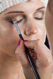 Woman having her makeup applied Stock Photo