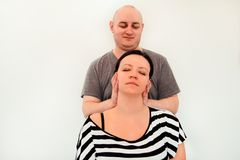 Woman having her neck massaged by a physiotherapist royalty free stock image