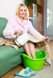Woman having hot bath for feet Royalty Free Stock Images