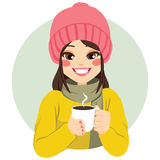 Woman Having Hot Chocolate. Beautiful woman wearing winter clothes having cup of hot chocolate Royalty Free Stock Photography