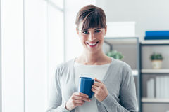 Woman having an hot coffee Royalty Free Stock Photos