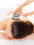 Woman having hot stone massage in spa salon. Stock Image
