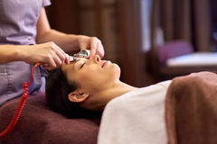 Woman having hydradermie facial treatment in spa Royalty Free Stock Photo