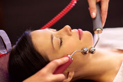 Woman having hydradermie facial treatment in spa Stock Photo