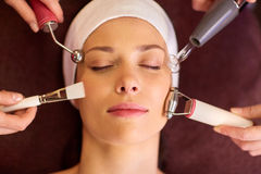 Woman having hydradermie facial treatment in spa Stock Photos
