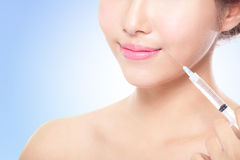 Woman having an injection above the lips Royalty Free Stock Image