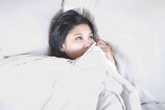 Woman having insomnia Stock Images