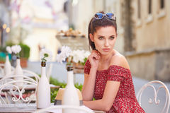 Woman having italian coffee at the cafe on the street in Toscana. City. Soft focus with small depth of field Stock Photos