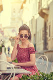 Woman having italian coffee at the cafe on the street in Toscana. City. Soft focus with small depth of field Stock Photo