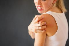 Woman having itchy skin disease. Woman having health problem royalty free stock photography