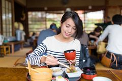 Woman having japanese meal in restaurant Royalty Free Stock Images