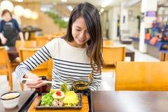 Woman having japanese soba in restaurant Stock Photo