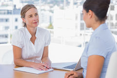 Woman having a job interview with a businesswoman royalty free stock images