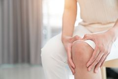 Woman having knee pain in medical.  royalty free stock photography
