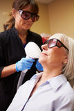 Woman Having Laser Treatment At Beauty Clinic Royalty Free Stock Images