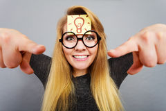 Woman having light bulb mark on forehead thinking Royalty Free Stock Image