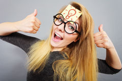 Woman having light bulb mark on forehead thinking Royalty Free Stock Photography