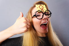 Woman having light bulb mark on forehead thinking Stock Image