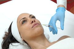 Filler Lips. Woman Having Lips Augmentation Filler Injection at Beauty Clinic stock photography