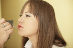 Woman having make up applied Stock Photo