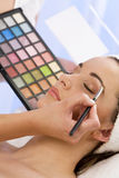 Woman Having Make Up Applied by Beautician at Spa Royalty Free Stock Photos