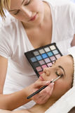 Woman Having Make Up Applied by Beautician at Spa Stock Photo