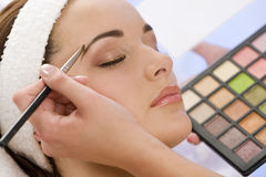 Woman Having Make Up Applied by Beautician at Spa royalty free stock image