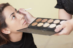 Woman having makeup applied Stock Photography