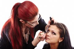 Woman having makeup applied by makeup artist Royalty Free Stock Photography