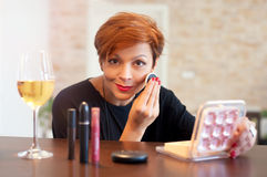 Woman having makeup applied Stock Images
