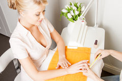 Woman having a manicure at the salon Stock Photos