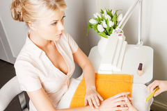 Woman having a manicure at the salon Stock Image