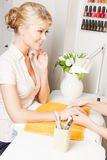 Woman having a manicure at the salon Royalty Free Stock Photos