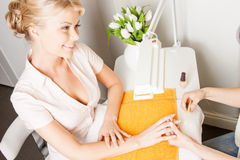 Woman having a manicure at the salon Royalty Free Stock Image