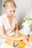 Woman having a manicure at the salon Stock Photo