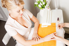 Woman having a manicure at the salon Royalty Free Stock Photo