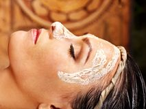 Woman having mask at ayurveda spa. Royalty Free Stock Photography