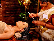 Woman having mask at ayurveda spa Stock Photos