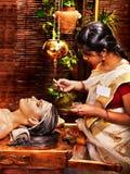Woman having mask at ayurveda spa. Stock Photos