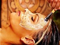 Woman having mask at ayurveda spa. Woman having facial mask at ayurveda spa stock photos