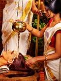Woman having mask at ayurveda spa. Woman having facial mask at ayurveda spa stock image