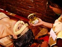 Woman having mask at ayurveda spa. Woman having facial dough oil eyes mask at ayurveda spa royalty free stock image